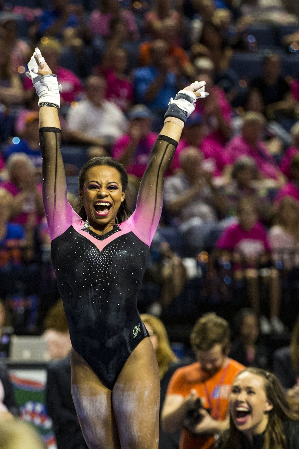 Florida Gator Kennedy Baker celebrates after competing in the uneven bars during the match against Arkansas on February 23, 2018. The Gators beat Arkansas 197.725-196.875.