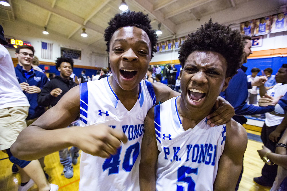 P.K. Yonge Adrian Bloodworth and Israel Wilcox celebrate after their the Region 1-4A boys basketball final win over Providence at P.K. Yonge High School on February 27, 2018. P.K. Yonge beat Jacksonville Providence 43-42.