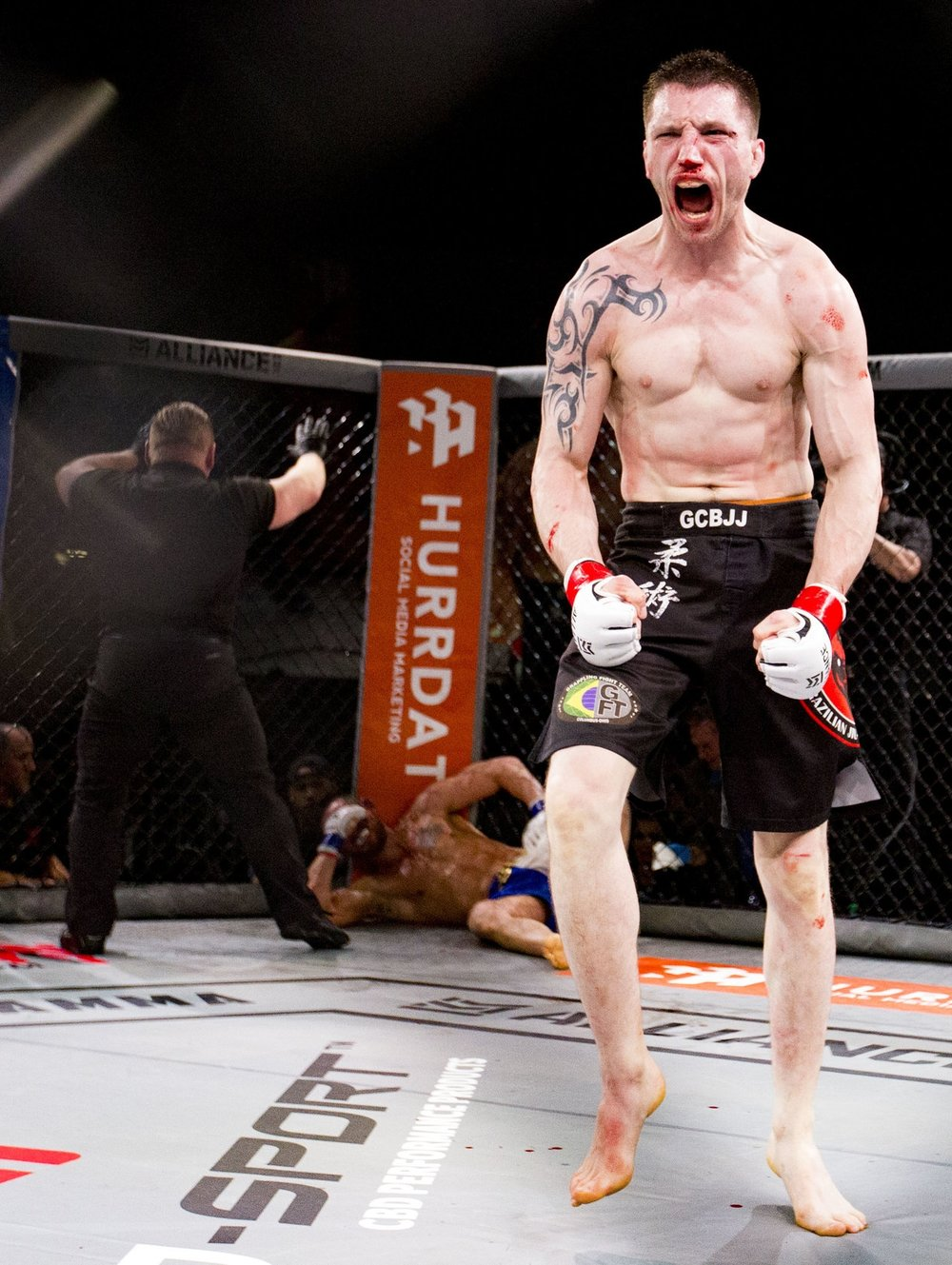An MMA fighter celebrates after his knockout win during the Alliance MMA competition at the Arnold Sports Festival in Columbus, Ohio on March 3, 2018.