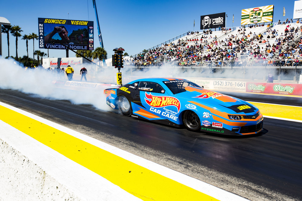 A driver reverses into the starting line during the NHRA drag racing competition at the Gainesville Raceway on March 16, 2018.