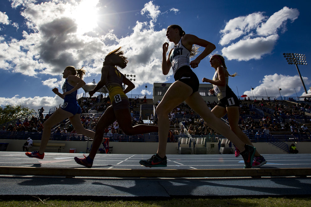 High school girls compete in the 1600 meter run during the Florida Relays at the University of Florida Percy Beard Track on March 29, 2018.