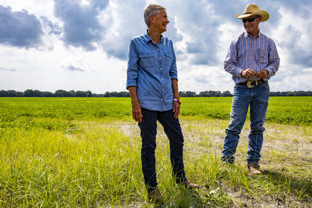 Lynetta Usher Griner and Ken Griner laugh at each other while standing in a peanut field outside of a timber harvest site on July 12, 2018. Lynetta Usher Griner was recently named the 2018 Florida Farmer of the Year by the Florida Farm Bureau Federation for her work as a community and state leader.