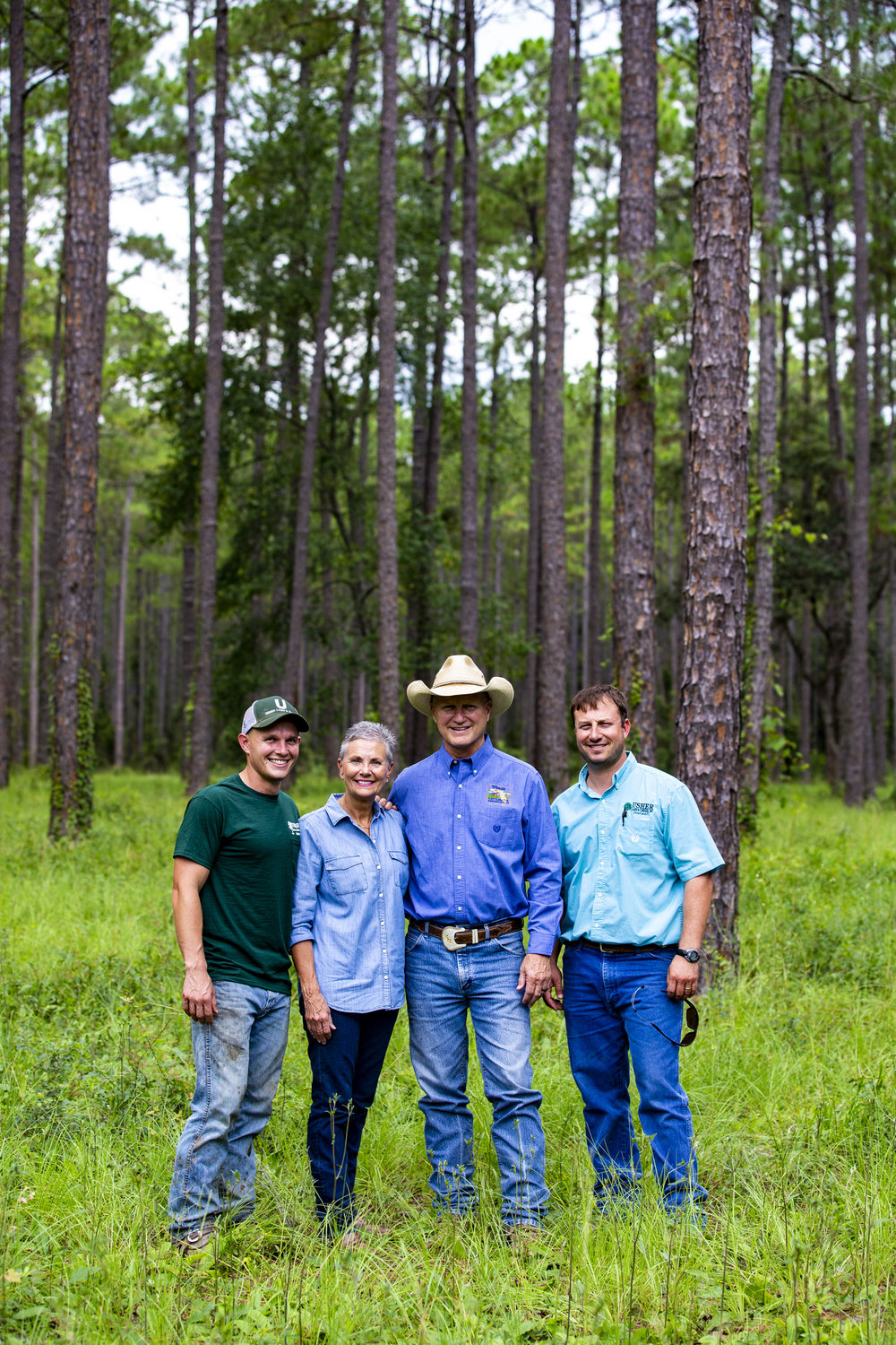 Left to right, Korey Griner, Lynetta Usher Griner, Ken Griner and Eric Handley pose for a portrait on their property. Lynetta said Farmer of the Year belongs to her son, husband and business partner as well because the farm is a group effort.
