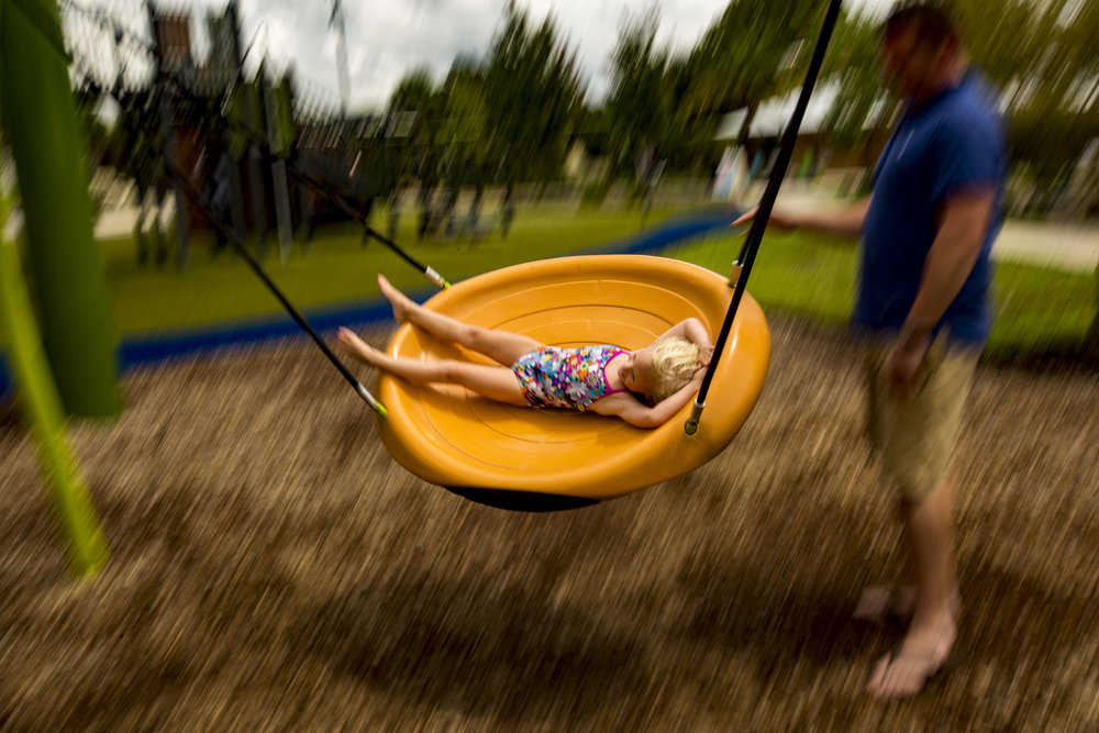 Paul Adamson pushes his daughter Mackenzine, 4, on the swing at Depot Park on Labor Day.