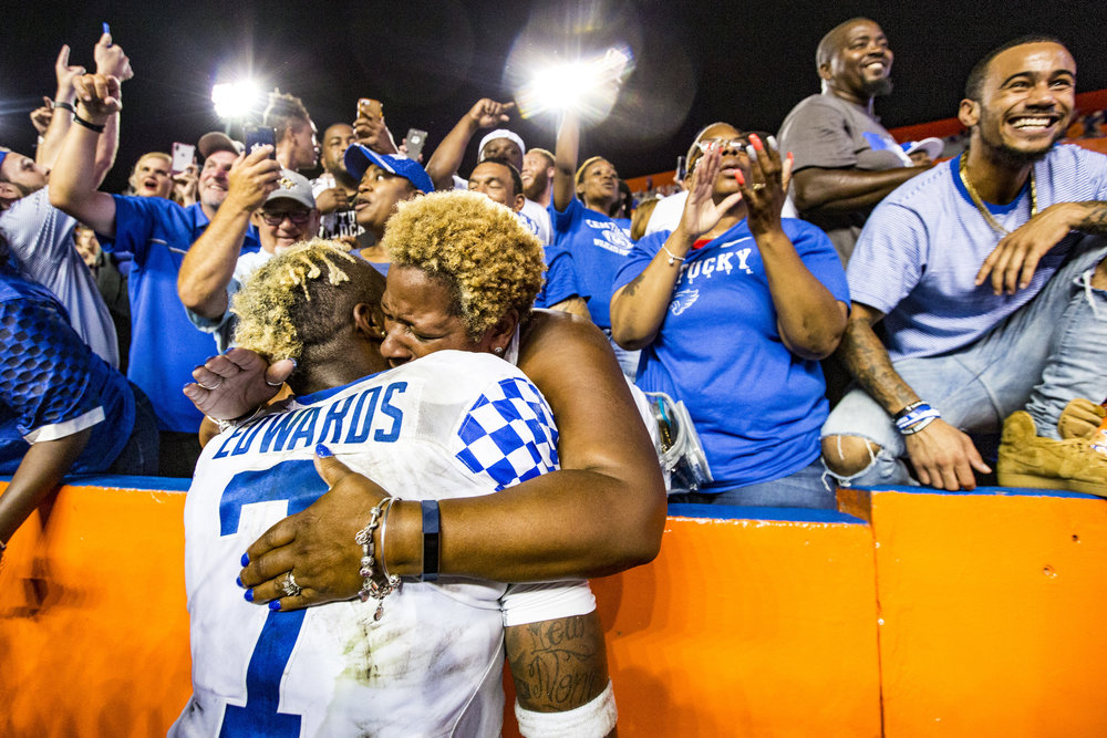 Kentucky Wildcats safety Mike Edwards (7) is hugged by fans after their game against the Florida Gators on September 8, 2018. The Kentucky Wildcats beat the Florida Gators 27-16, securing their first win over Florida in 32 years.
