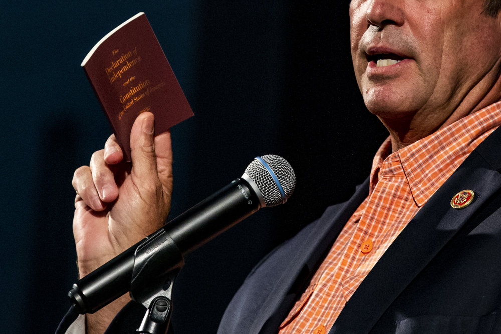 Congressman Ted Yoho holds up a copy of the Constitution and the Declaration of Independence while talking to the crowd at the 16th Annual Ronald Reagan Black Tie & Blue Jeans BBQ at Legacy Park in Alachua on October 11, 2018.