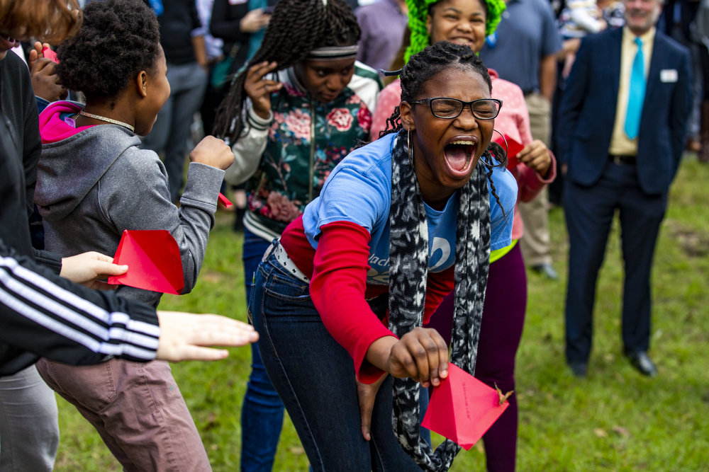 """Girls scream in delight as they release butterflies during the ribbon cutting ceremony for the PACE Center for Girls' new """"Butterfly Center"""" on January 22, 2019."""