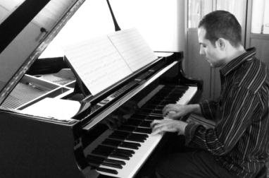 Rago at piano.jpg
