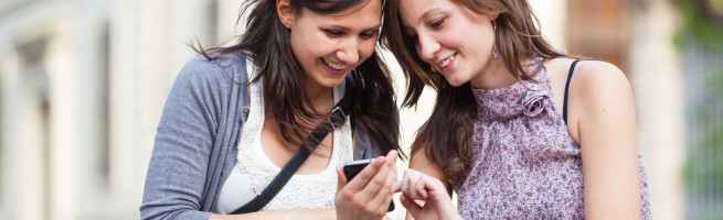 Two-Women-Sending-Messages-with-Mobile--655x200