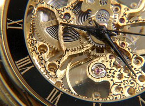 stock-footage-antique-clock-face-working.jpg