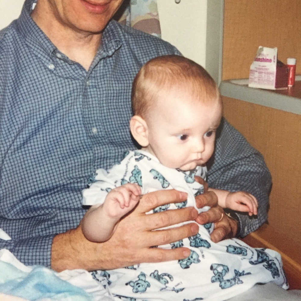 Grandpa Greg holding a pale, listless Steven while we waited for news.