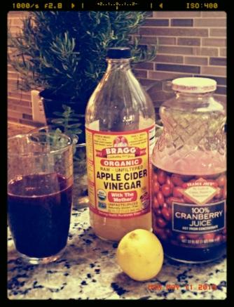 Organic apple cider vinegar and cranberry juice detox drink