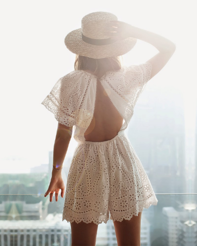 white crochet romper and fedora