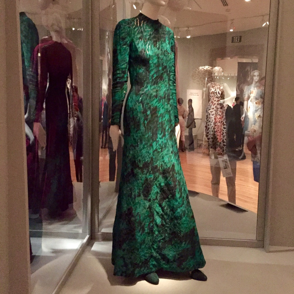 Elsa Schiaparelli. Dress, Winter 1937-1938. We couldn't get over how bold and before her time Schiaparelli's designs were. Her use of emerging materials (plastics) and custom designed textiles were a testament to her treatment of fashion as an artistic expression. This green number particularly caught our eye. The wood-grain printed fabric is underlaid with gold to mimic a tree and beautiful juxtaposed with a industrial zipper up the back.