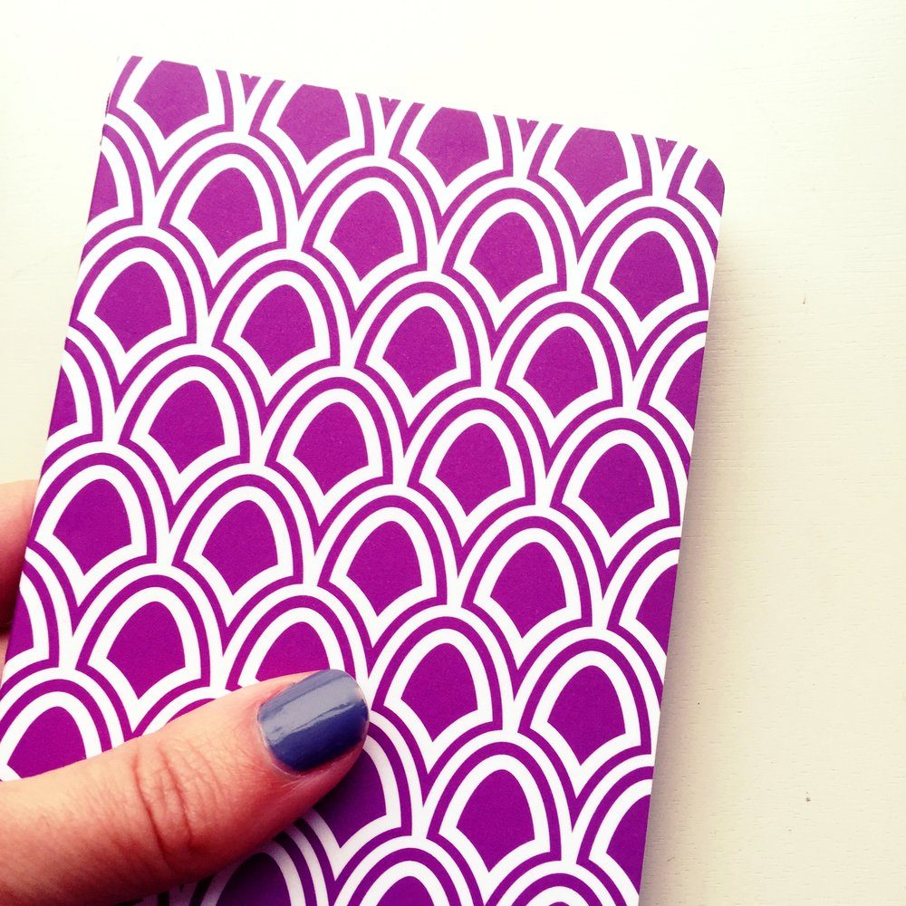 thumb-on-notebook