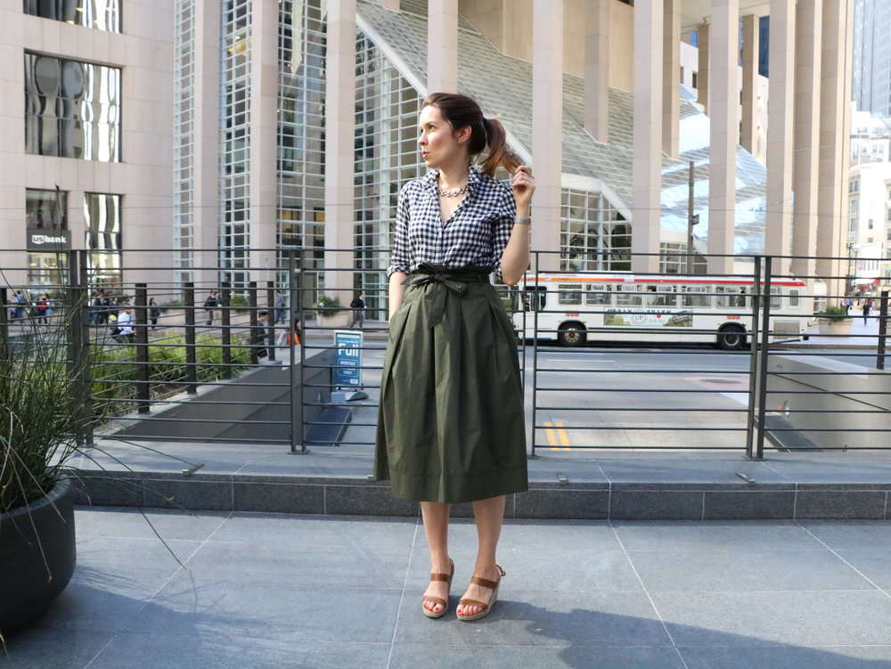 Get the Look:  J.Crew Check Shirt ,  Uniqlo High Waist Belted Flare Green Skirt , Jigsaw London Wedges ( similar ), Vintage Necklace