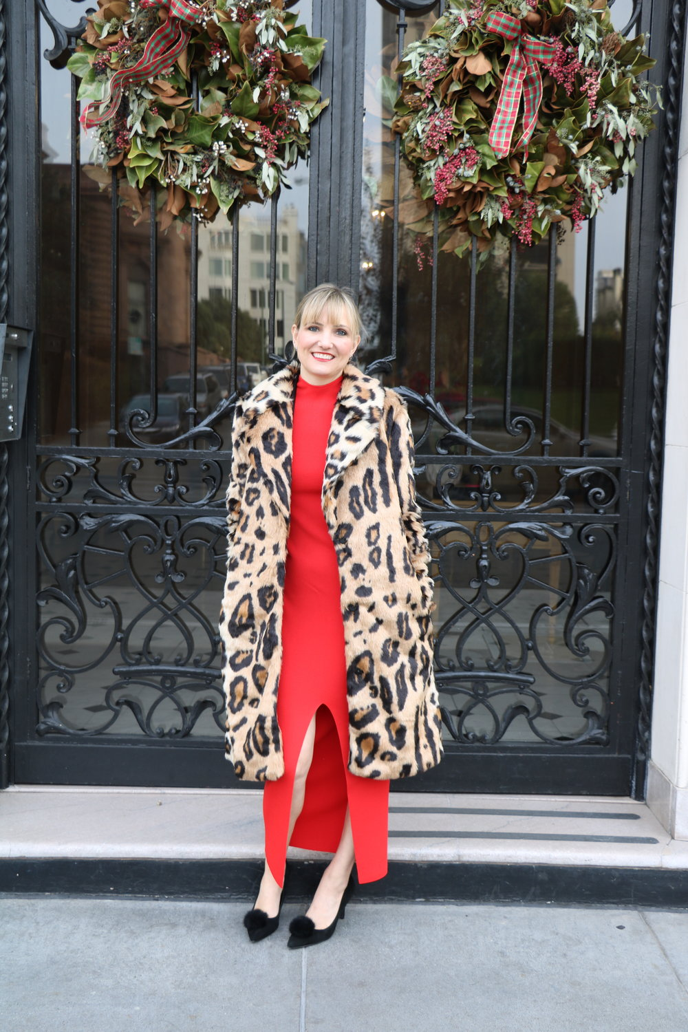 Outfit details:  Solace of London red front slit dress ,  Charles David pom pom heels , Forever21 tuxedo blazer ( similar ),  Show Me Your Mumu Miss Cindy faux fur overcoat , Jigsaw London Silver Clutch ( similar )