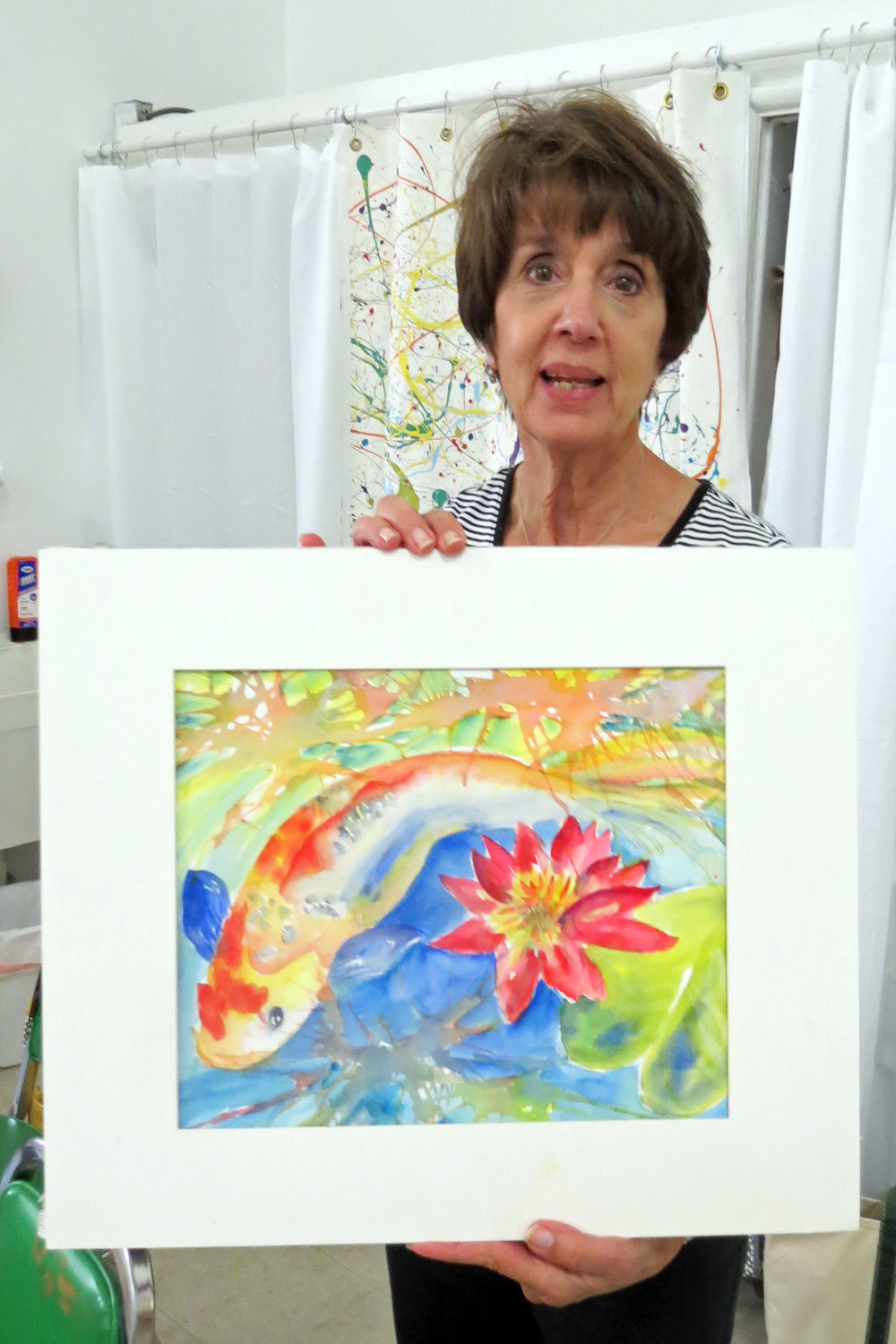 Annette with her painting.JPG