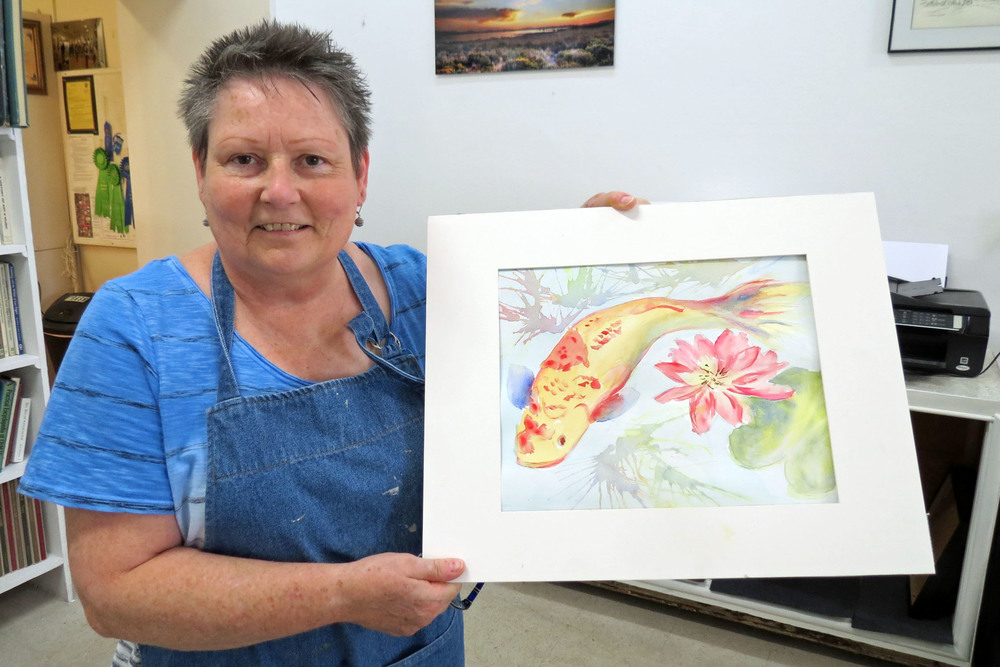 Becky Masters with her painting.JPG