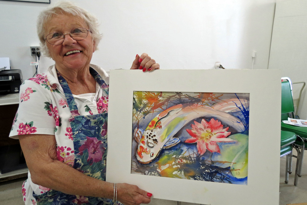 Elsa Bates smiling with her painting.JPG