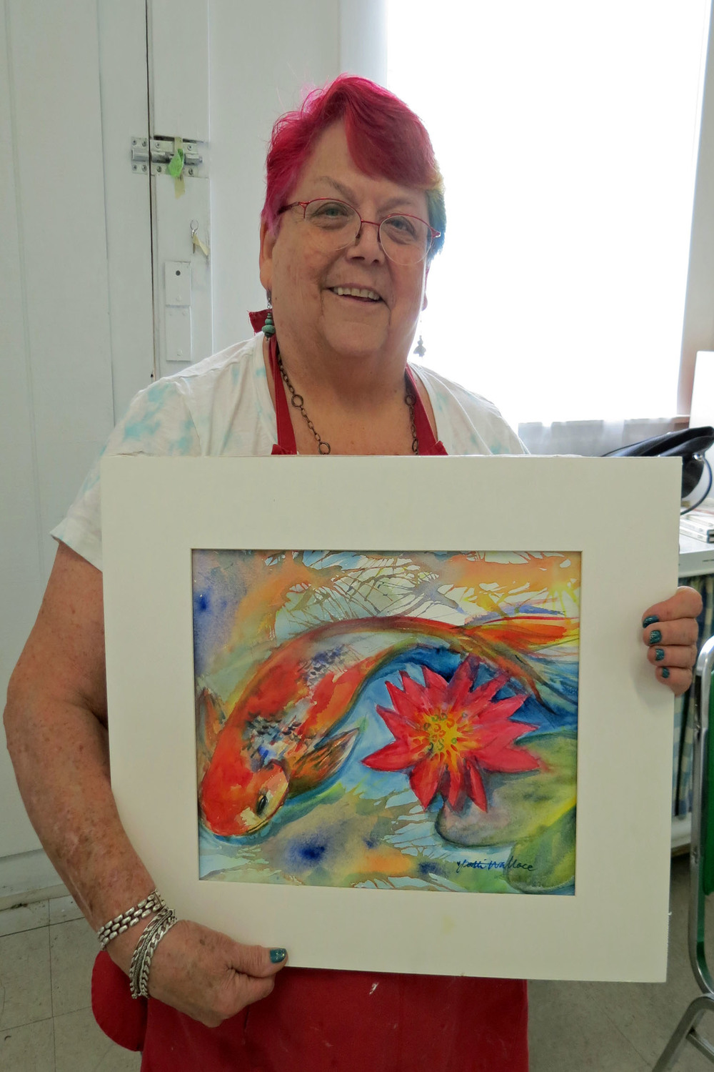 Patti Wallace with her painting.JPG