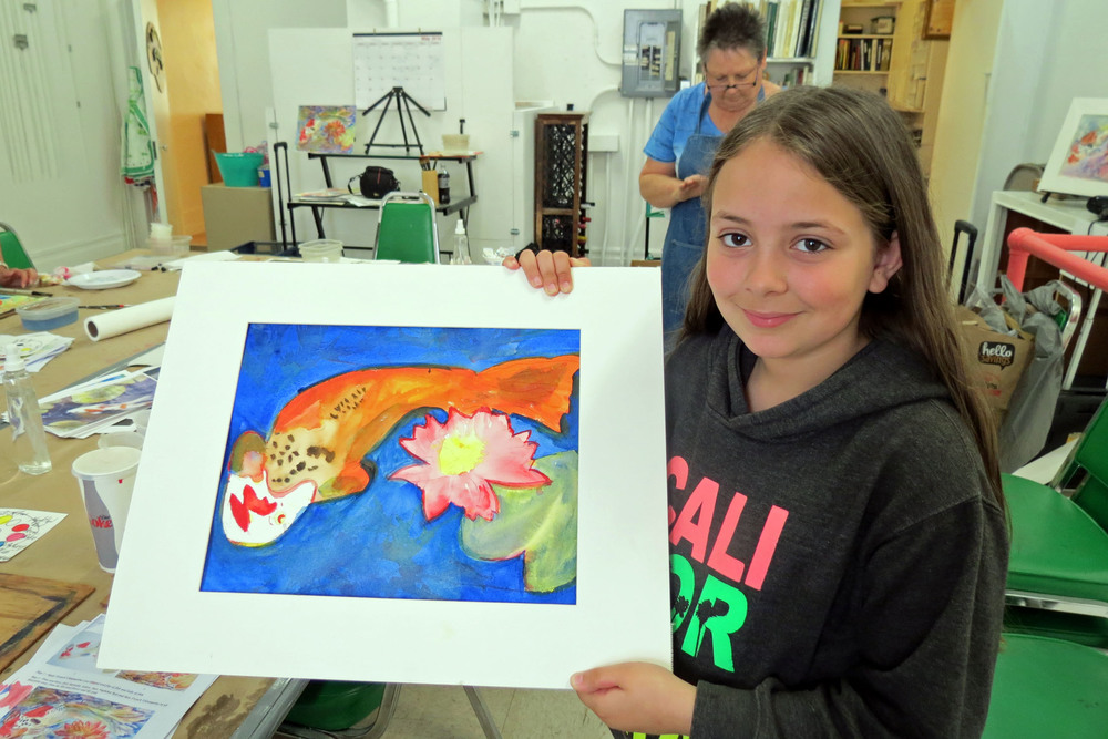 Madison Leon with her painting.JPG