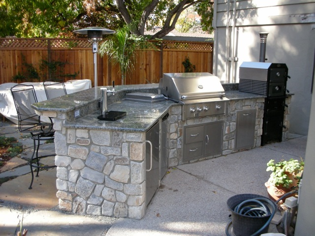 Outdoor Pizza Ovens & Smokers — Unlimited Outdoor Kitchens