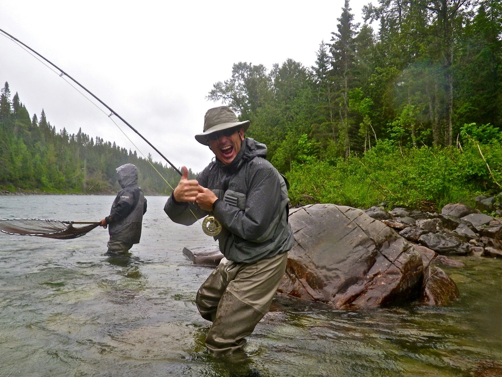 A very happy fisherman!  Patrice Giroux with his first salmon of 2015, congratulations Pat.