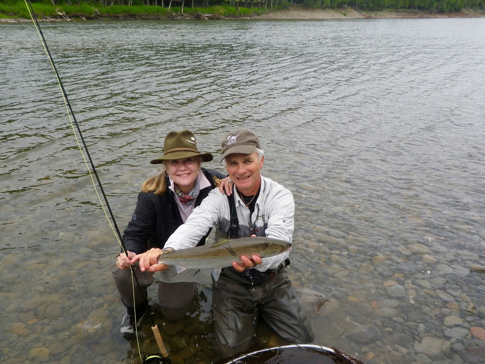 Camp Bonaventure guide Bruno Lepage with Isabel Jewell's first one of 2015. Nice Fish Isabel!