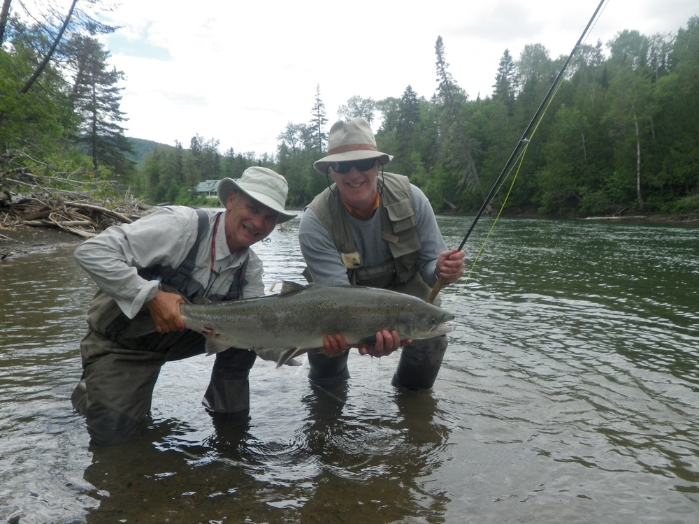 Camp Bonaventure guide Bruno (left) Lepage with angler David Guay, wow, nice one David!