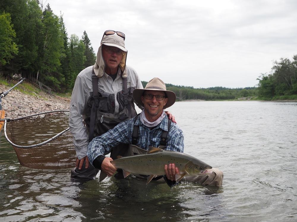 Camp Bonaventure guide Orrin Briard ( left) with angler John Ouelette, nice salmon John!
