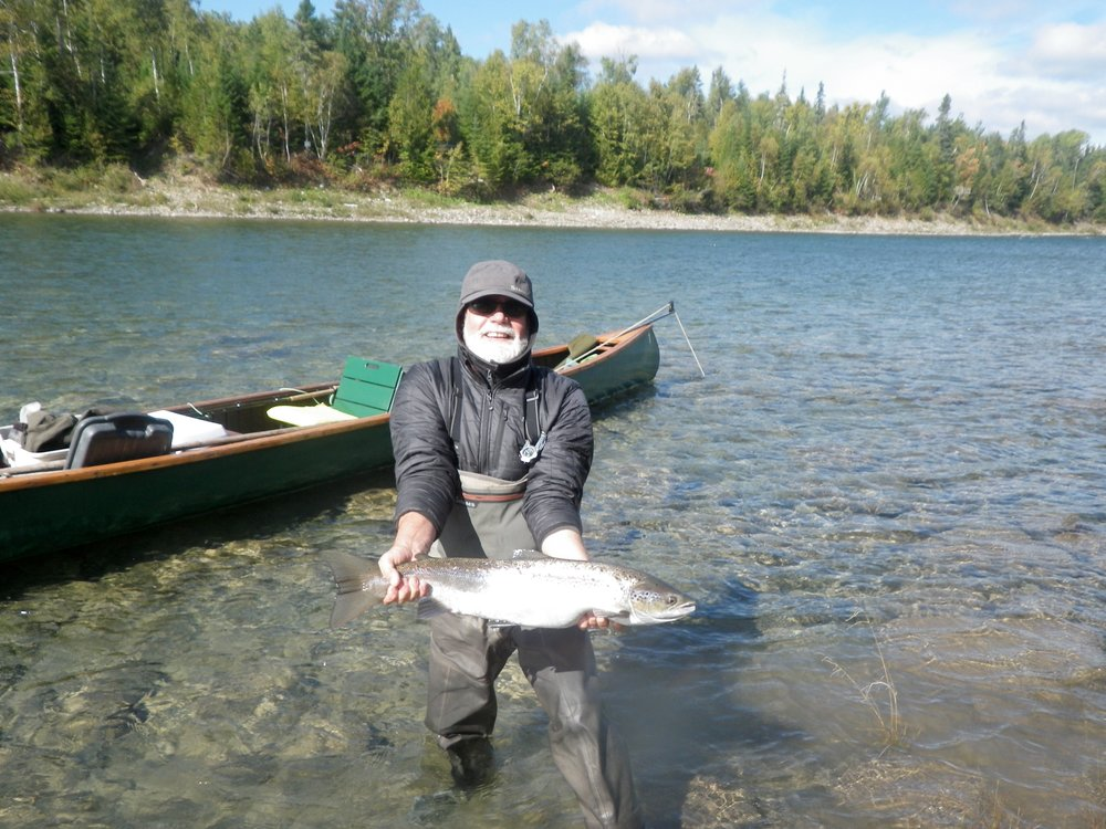 Camp Bonaventure regular Randy Spencer with a fresh run September salmon on the Bonaventure. Congratulations Randy!