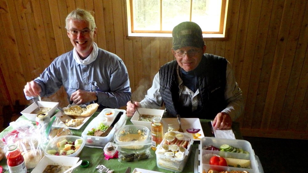 Fishing buddies John Wemekamp and Jack Gustafson enjoy a nice lunch and a short break from he cold water.