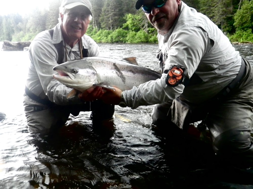 Camp Bonaventure regularJonathan Director  (left) and master guide John Law  with a beautiful fresh run salmon, congratulations Jon!