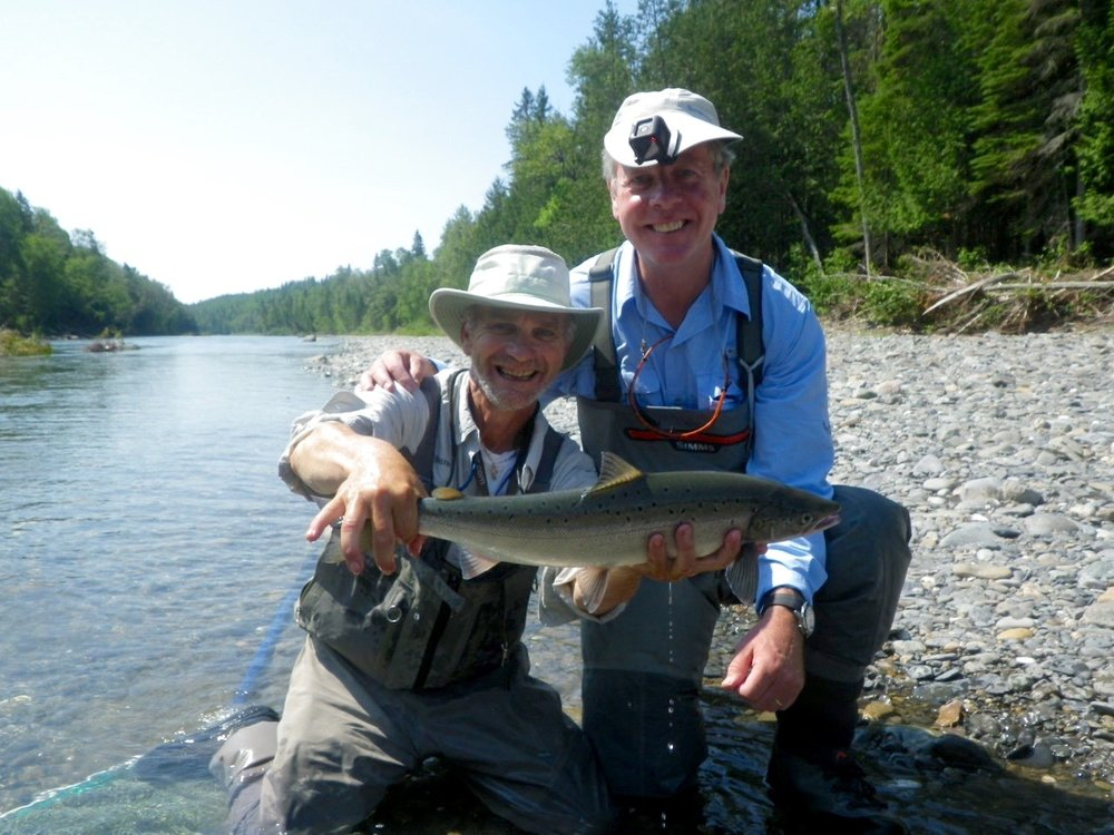 Eric Forgie (Right) with Camp Bonaventure Guide Bruno LePage, this was Eric's first on a dry fly1, Nicely done !