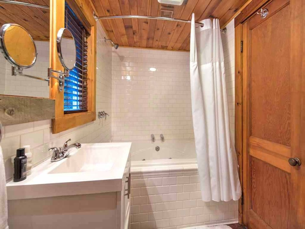 Master Bath - Two person jetted and heated soaking tubTwo shower headsGFCI protected power outletsAuxiliary heater and vent fanHair dryerTowels, washcloths and bathmatsToilet tissue for 3 daysShelving for toiletries