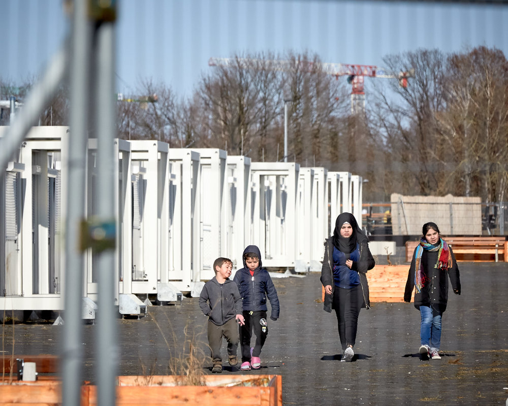 Nearly 500 refugees have been given temporary housing in a container village at the site of Berlin's former Tempelhof Airport
