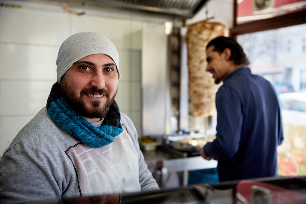 Chef and owner Abu Zaher from Damascus works with a staff of mostly Syrian refugees at Damascus Gate restaurant on Sonnenalle street