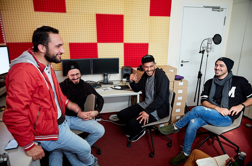 (L–R) Mohamed Alhalabi, a Syrian refugee now studying at Berlin's University of the Arts, in a university recording studio with friends from Damascus Yazan Albaour, Tareq Assad, and Odah Bashi