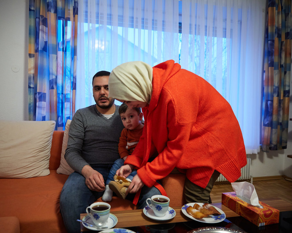 Syrian refugees Abdulrahman and Noura Alzghaer, with son Abdullah, feel fortunate to have found a Turkish landlord that would rent them an apartment in the Bavarian town of Kaufbeuren
