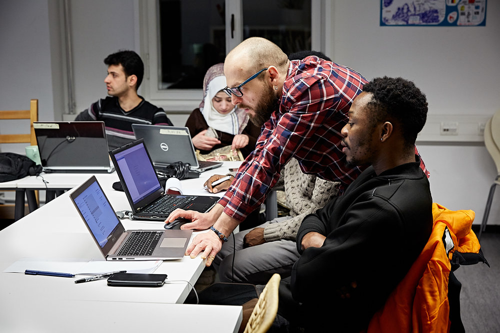 Alexander, a native of Greece working in Berlin's booming tech industry, is a volunteer teacher at ReDI School of Digital Integration, a nonprofit organization that teaches coding to tech-interested refugees and other newcomers to Germany