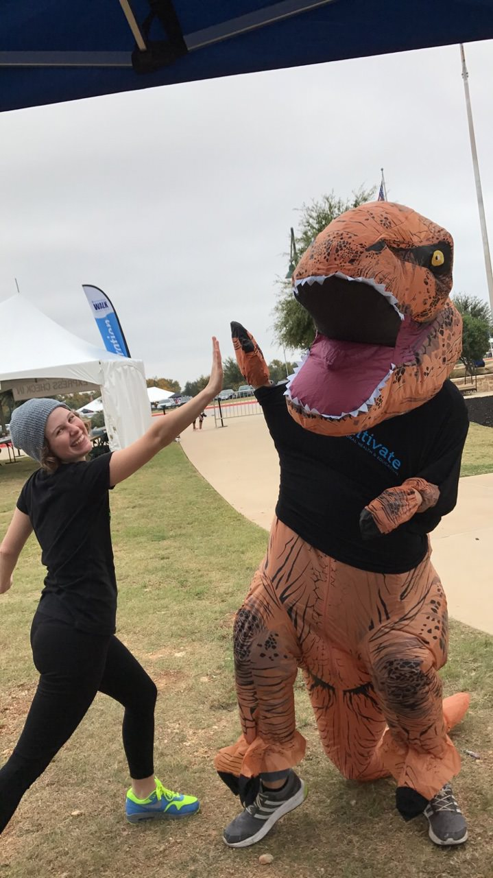 autism-speaks-austin-walk-2017-cultivate-behavioral-health-and-education-dinosaur-high-five.jpg