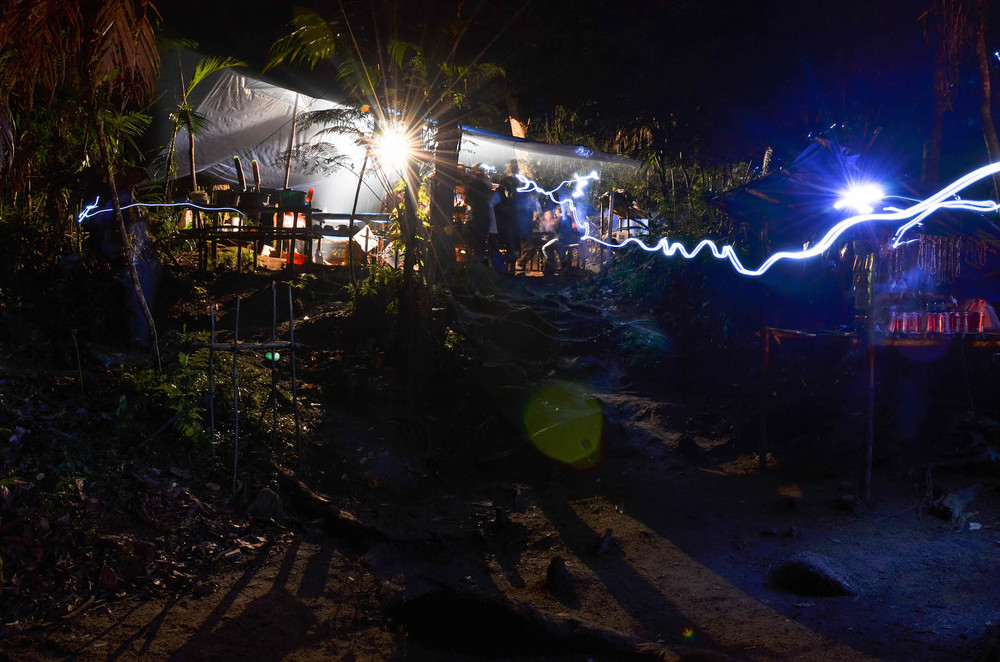 Night in the Jungle. Light strikes of scientist's head torches in a Research Camp after dark. Cusuco National Park, Honduras.