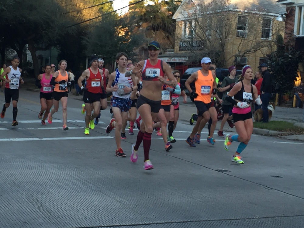 Smiling, waving and a Michael Jordan tongue wag for happiness. Rolling with the 2:45 pace group. Photo by Andrea Duke.