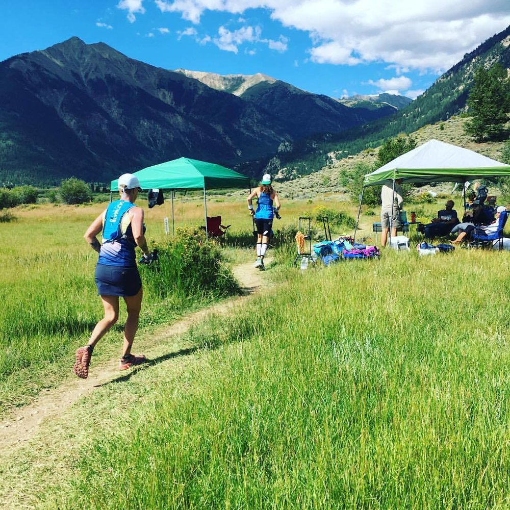 Leaving Twin Lakes out bound at mile 40, with HOKA teammate Mike Wardian. Photo by Amy Leedham.