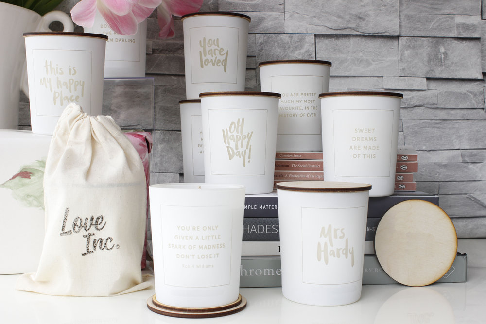 Product shot of hand lettered candles by Beth Cook Design