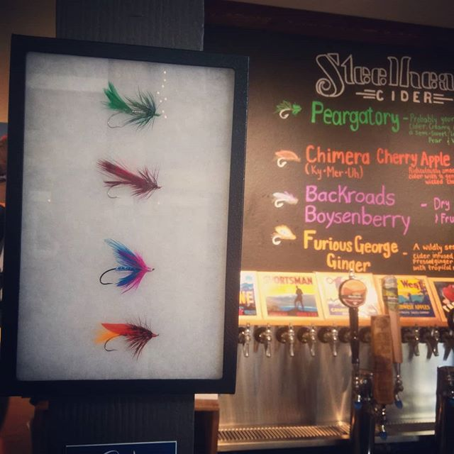We had a savvy fly-tier gift us some rad Steelhead themed flies. Thanks to @noah.edwds for the sweet addition the tasting room decor! #steelhead #steelheadcider