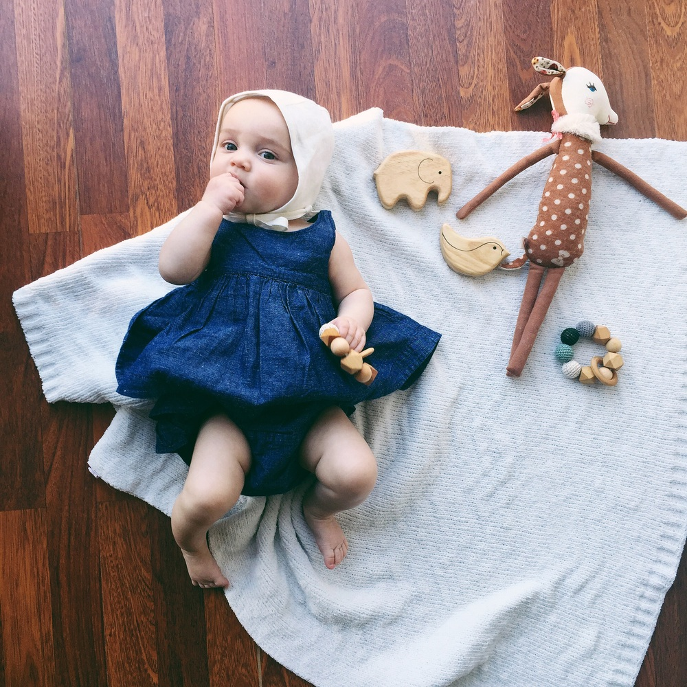 You can add a blanket like I did here to add texture, place a few simple wooden toys and viola!! Out fit: Baby Gap teethers: Oh Just Dandy Stuffed toy: By Maileg from the Fawn Shoppe Wooded toys: by Green Tones from Amazon