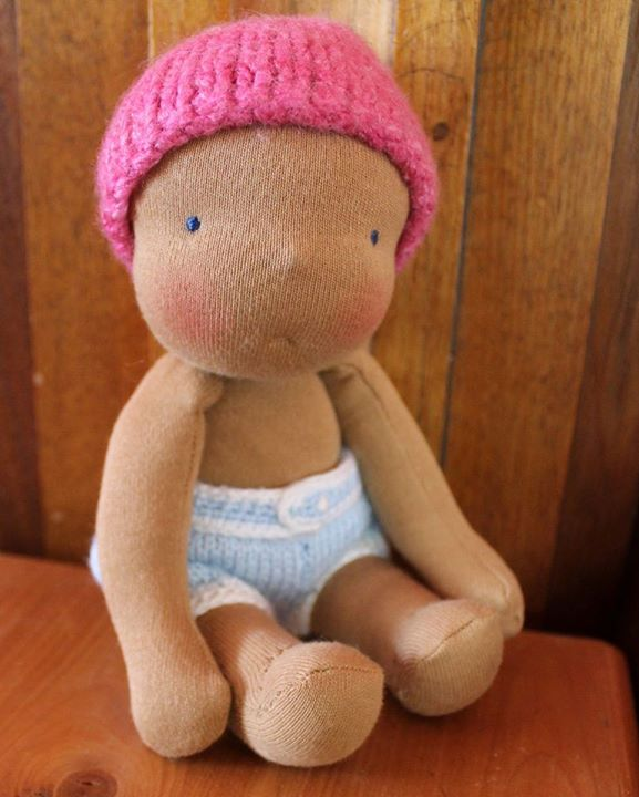 The first little Bubbie, wearing the knitted pants from the doll my mum bought me. Apart from these pants and the hat the rest of the outfit didn't really fit.