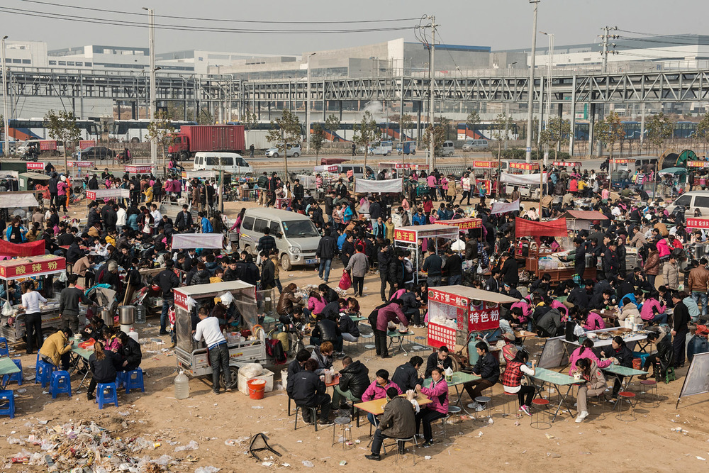 At lunch break hundred of factory workers have left the factory to have food at the stalls which are catering to them. Foxconn provides food for its workers but many of them prefer to eat out because, they say, of the poor taste/quality of the one provided by their employer.